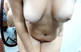 Big ass and big tits, hairy mature woman masturbates solo in front of webcam