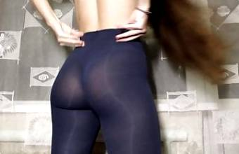 Fitness girl shows her ass in leggings. Inserts fingers