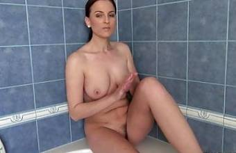 Horny chick shaves herself while showering on camera