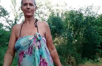 Lukerya takes off her bra in the forest