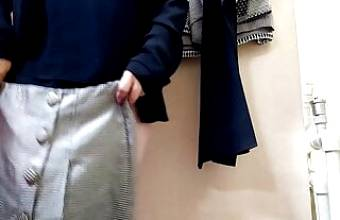 OMG! Russian mommy trying on skirts in a fitting room