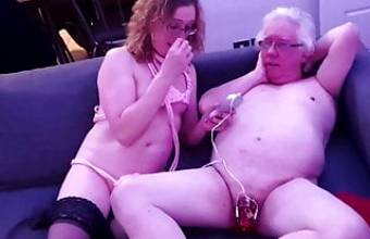 Shocking John's cock with the electro stim cock cage
