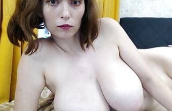 Brunette with big and natural breasts caresses her pussy