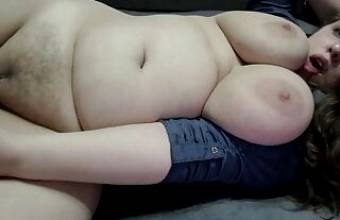 Chubby girl caresses her sexy body