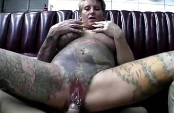 Full body tattooed milf with pussy piercing fucks