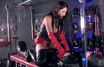 Leather mistress and toy boy slave