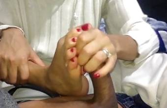 My girlfriend in pajamas jerks me off with her hands and feet