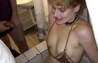 Redhaired German woman pissed on in a bathroom on New Year's Eve